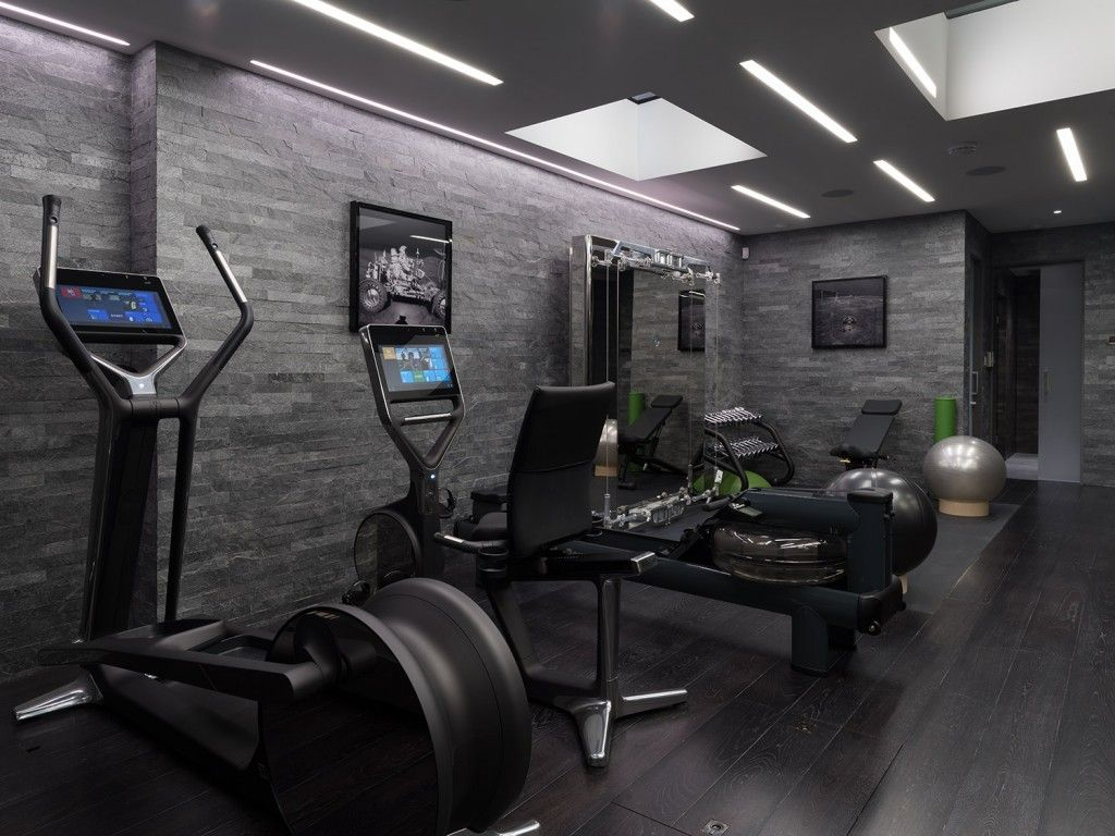 Dark interior of the dark stone finished wall basement home gym