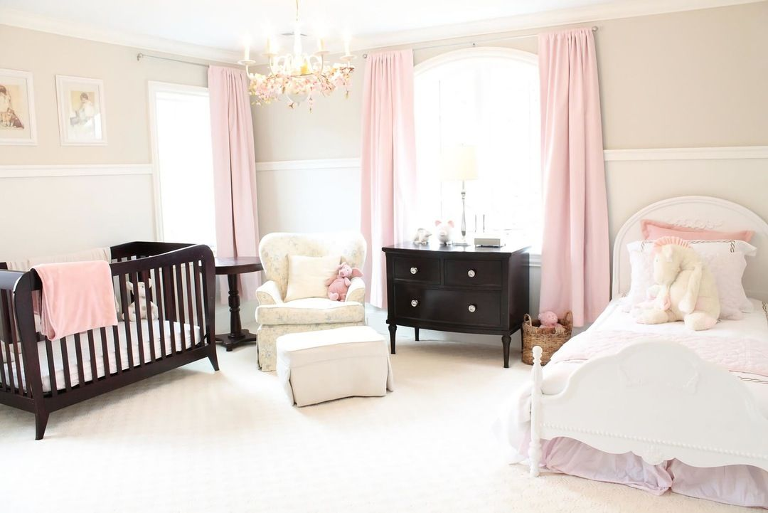 Pale pink details for large bedroom with black furniture