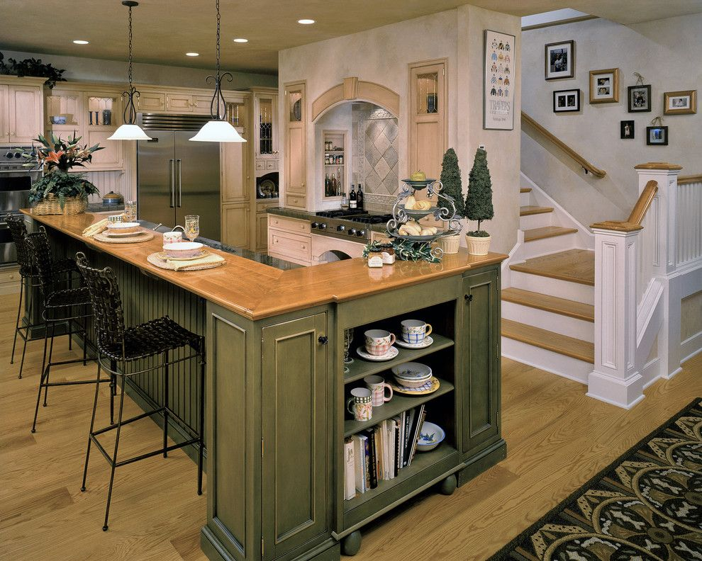 Olive Color for Interior Decoration. Real Photo Examples. Combined space if large classic decorated kitchen and the entrance with stairs