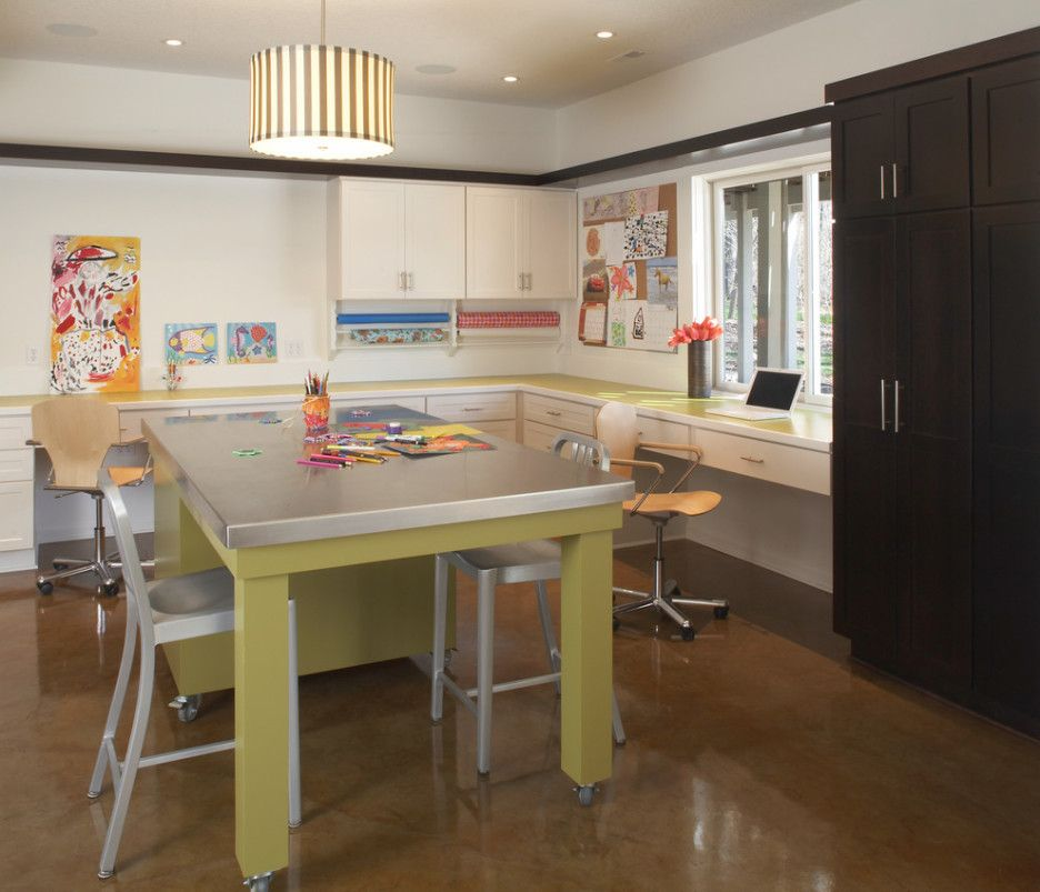 Bright olive table as an accent for the large Casual styled kitchen
