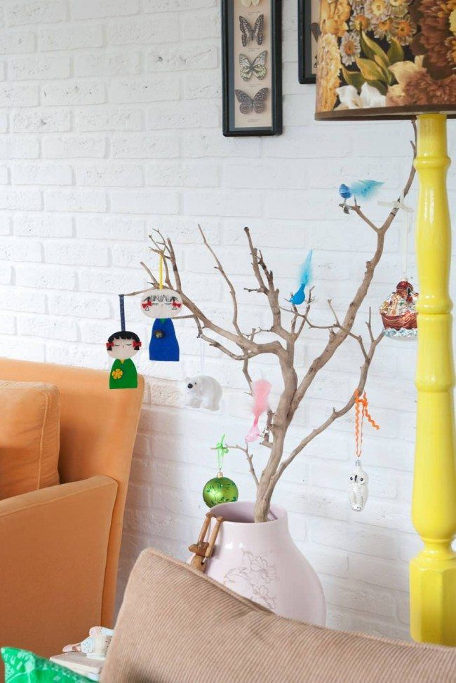 How to Decorate your Home with DIY Creative Elements. Whitewashed wall with the branch decorated as the improvised tree