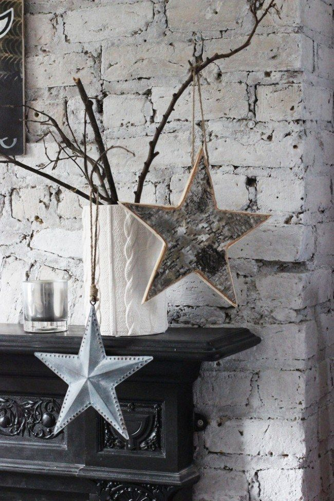 How to Decorate your Home with DIY Creative Elements. Whitewashed brickwork and the hanged handmade stars