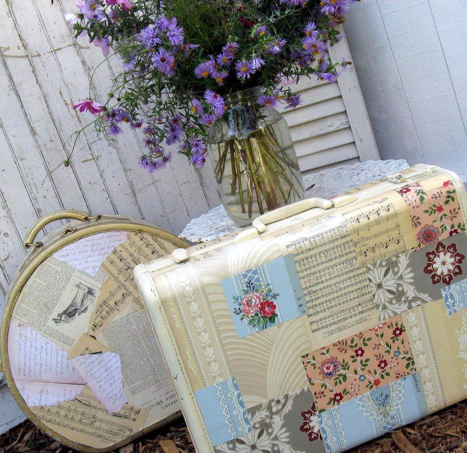 Suitcases glued with newspapers and postcards