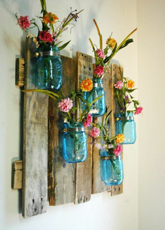 How to Decorate your Home with DIY Creative Elements. Blue bottles as the vases for a real installation on sackcloth base
