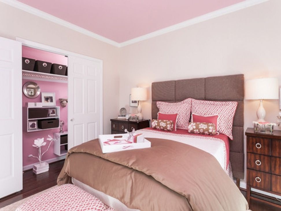 Gorgeous contemporary design for the bedroom with pale pink ceiling and shelving and upholstered quilted headboard