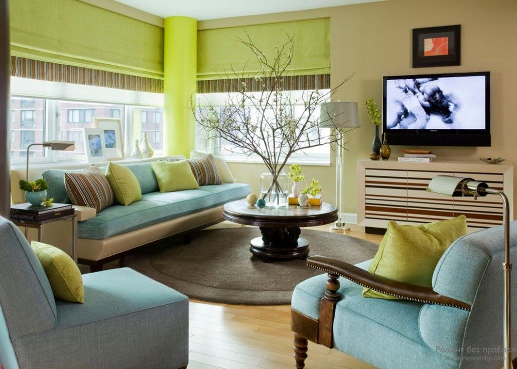 Salad green walls and pale blue furniture mix in the large living room