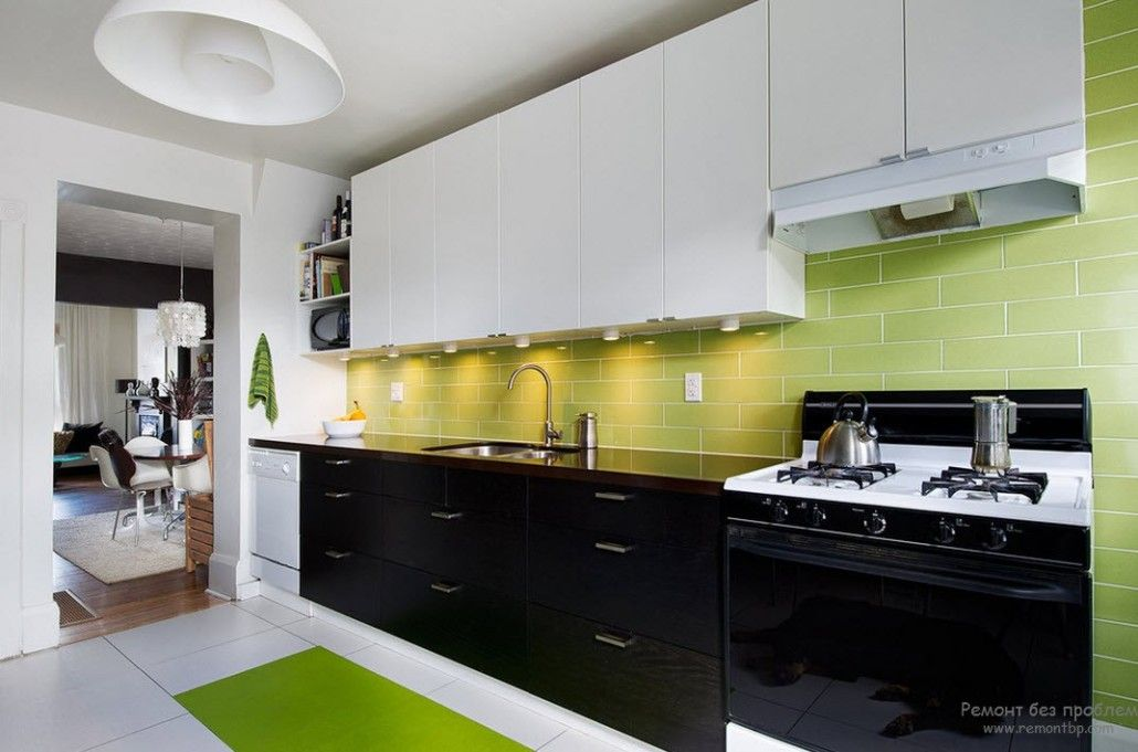 Green LED enlighted backsplash in the hi-tech styled kitchen with dark bottom tier