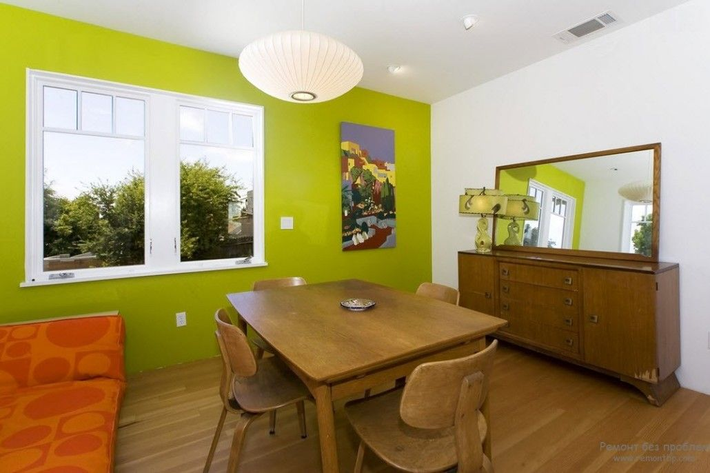 Green accent wall for the dining room and the wooden furniture set in Eco styled kitchen
