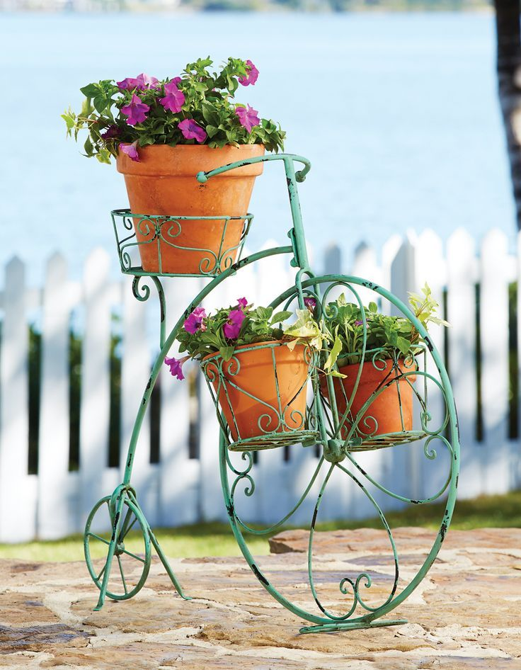 Flower Stand as Functional & Interior Decorating Element. Green painted bicycle as the flower bed