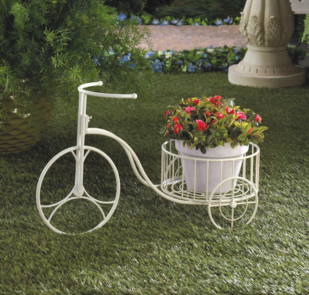 Flower Stand as Functional & Interior Decorating Element. White metal forged tricyle