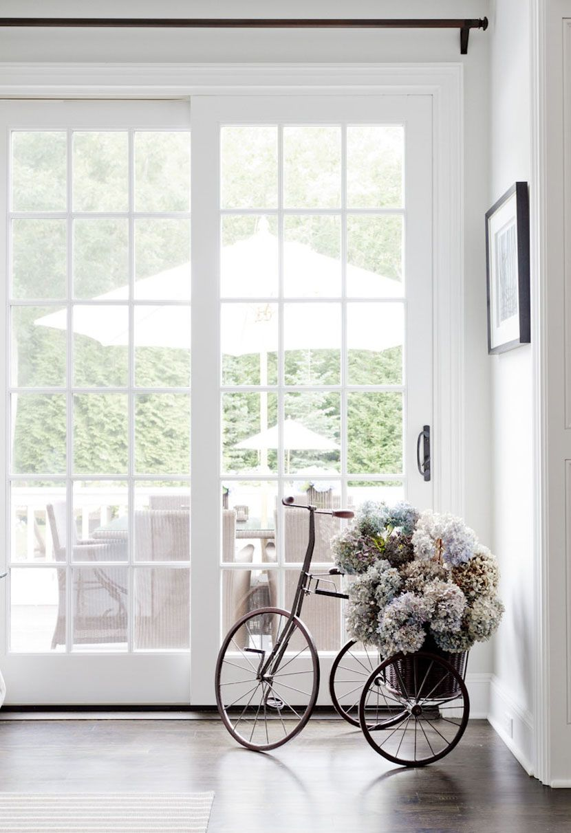 Flower Stand as Functional & Interior Decorating Element. Forged bicycle at the entrance to the private house