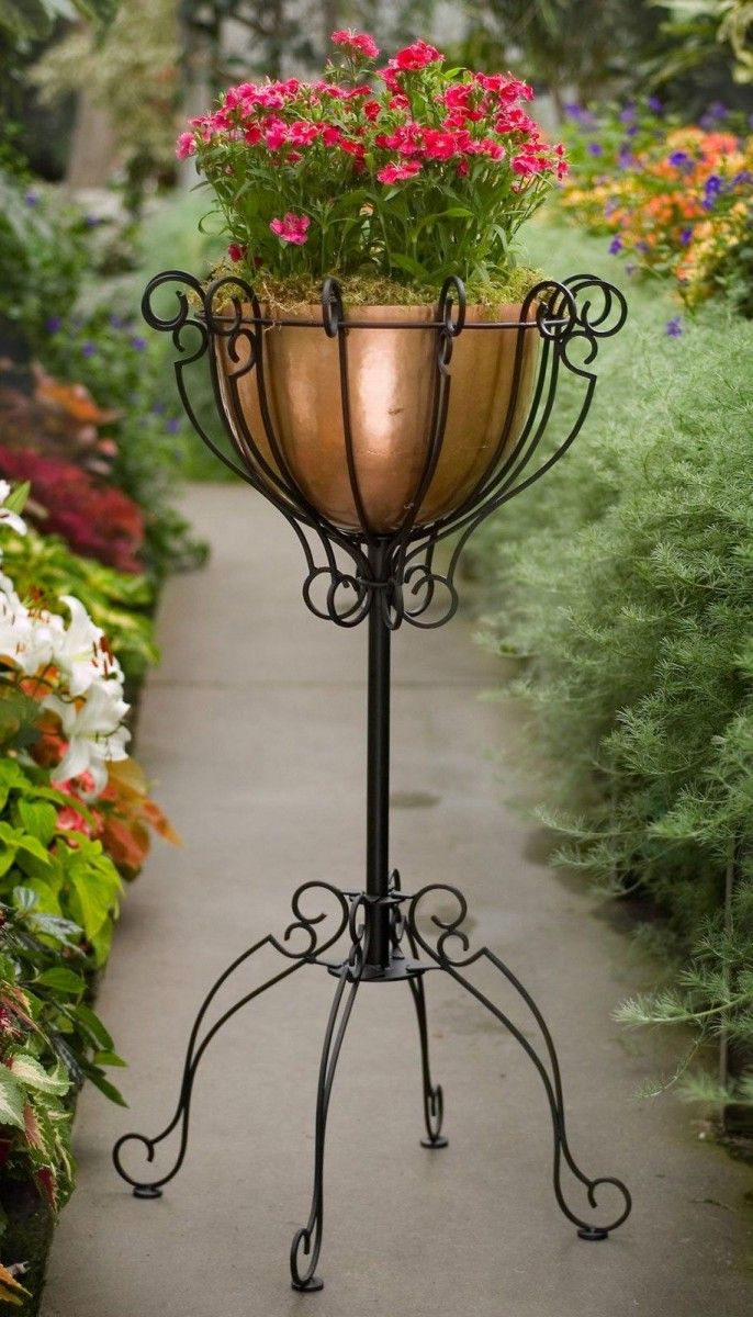 Flower Stand as Functional & Interior Decorating Element. Lantern looking high black metal forged construction for the garden