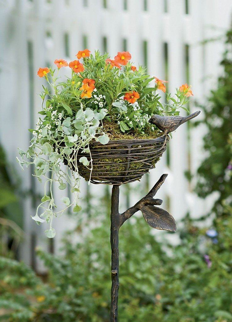 Flower Stand as Functional & Interior Decorating Element. Stork nest looking design