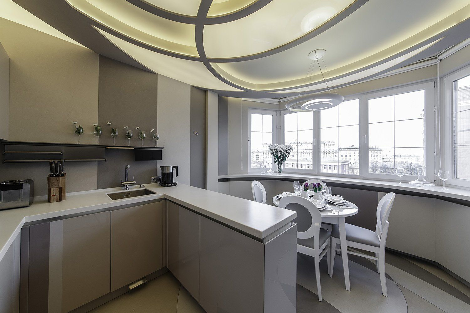 Kitchen Combined with Loggia or Balcony Design Ideas. Another successful design in hi-tech style with unusual circles ceiling design