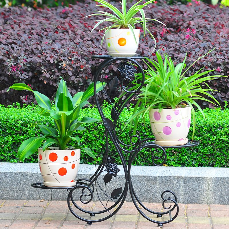 Black forged construction for flower support for three pots