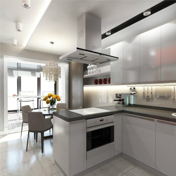 Modern open layout hi-tech designed kitchen with steel surfaces of the hood