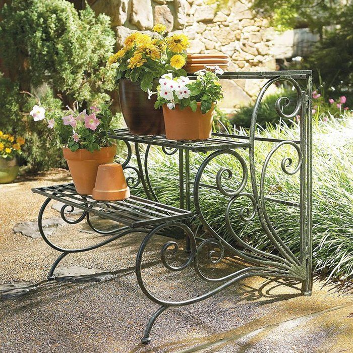 The bench looking metal construstion with two surfaces for flowers