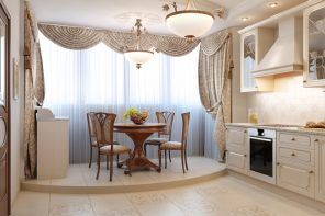 Classic designed kitchen with the dining zone in the balcony zone and on the pedestal of the floor difference