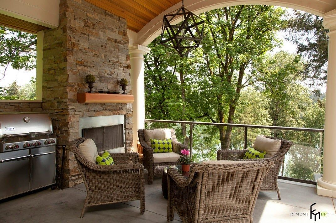 Patio furniture outdoor. Reviewing Types with Photo. Stone walls and the wicker armchairs around the table