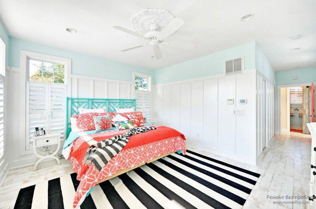 Turquoise Color in Modern Bedroom Interior. White and black zebra floor covering and turquoise headboard