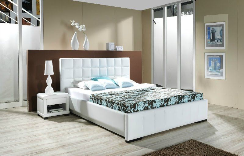 Bedroom with show white bed and headboard