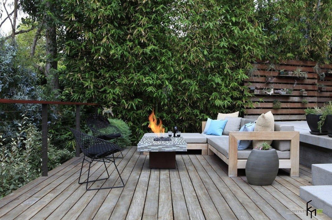 Patio furniture outdoor. Reviewing Types with Photo. Green wall and barbeque zone