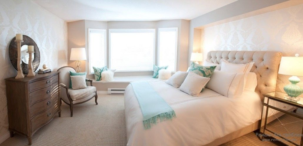 Intimate touch of turquoise color in the form of bedding and pillows