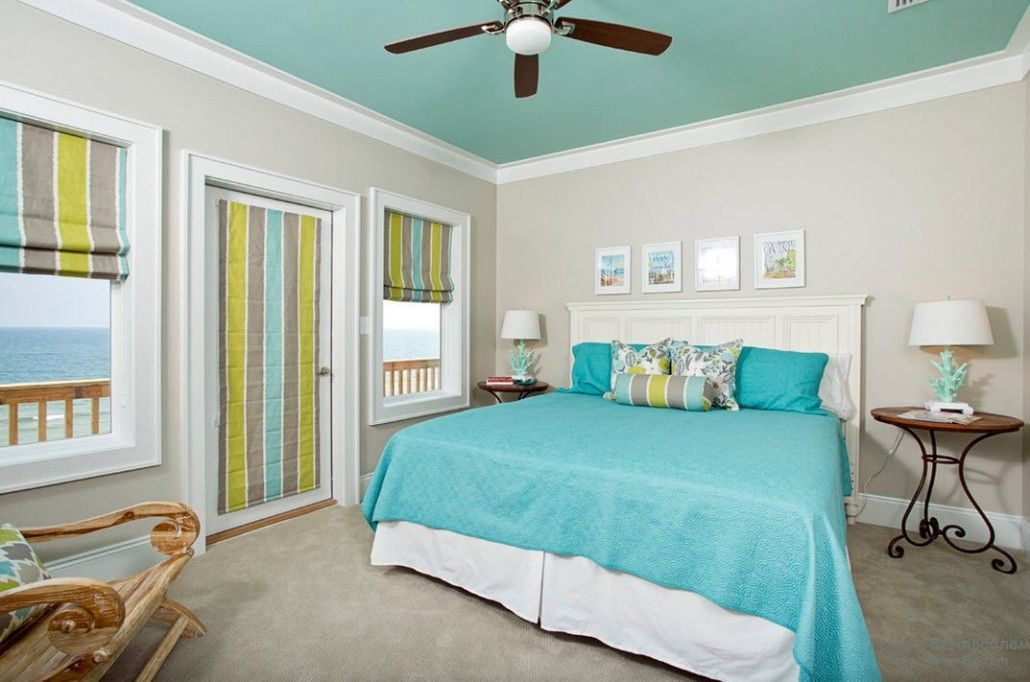 Turquoise Color in Modern Bedroom Interior. Bedding and ceiling in turquoise and multicolored cabinet