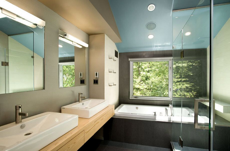 Absolutely gorgeous Modern styled natural finished bathroom with dark trimmed bathtub