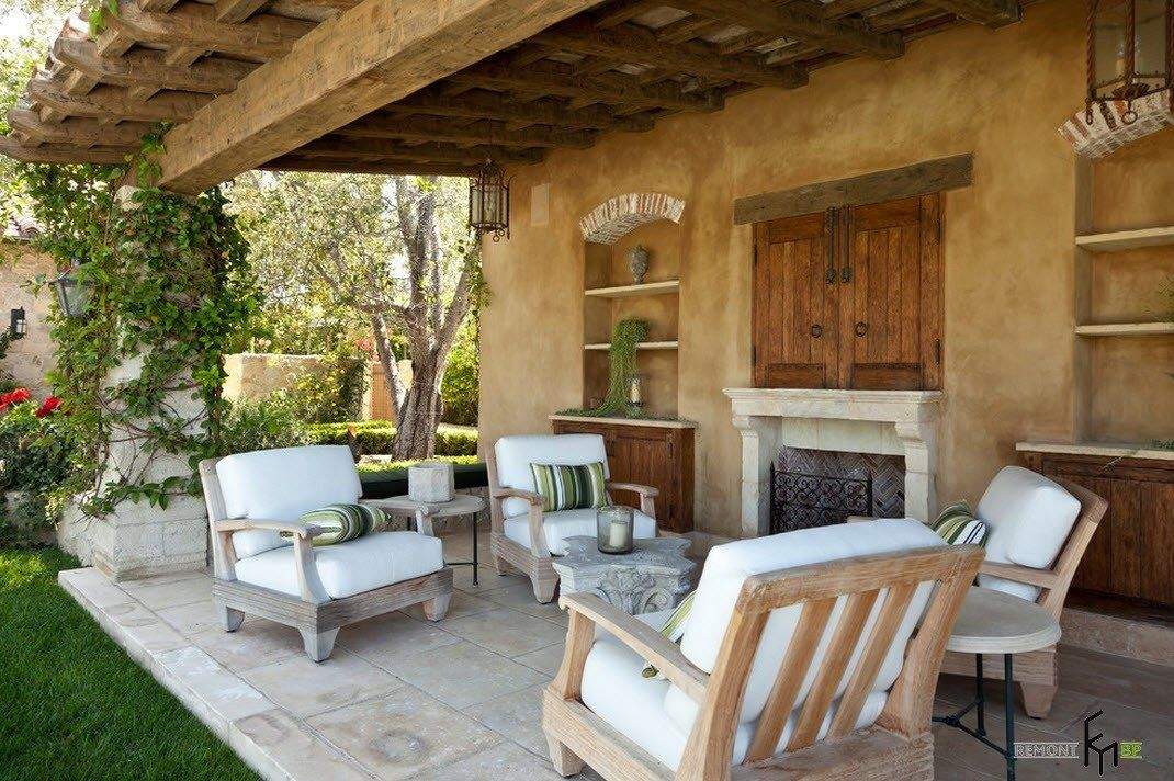 Patio furniture outdoor. Reviewing Types with Photo. Back side of the house canopy with white upholstered furniture