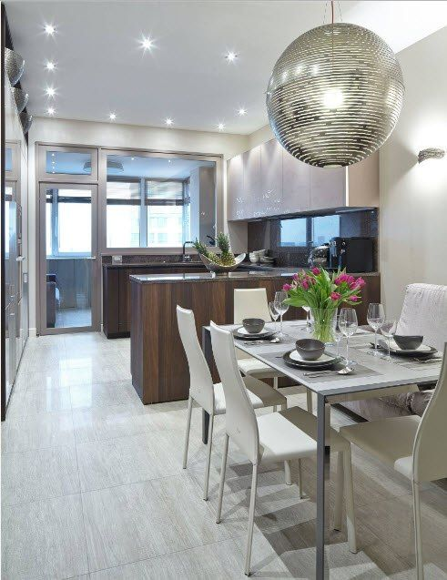 Kitchen Combined with Loggia or Balcony Design Ideas. Plenty of artificial light in the modern styled interior
