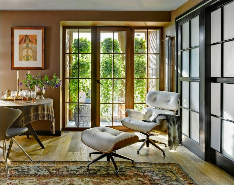 Classic designed interior with white upholstered Eames chair