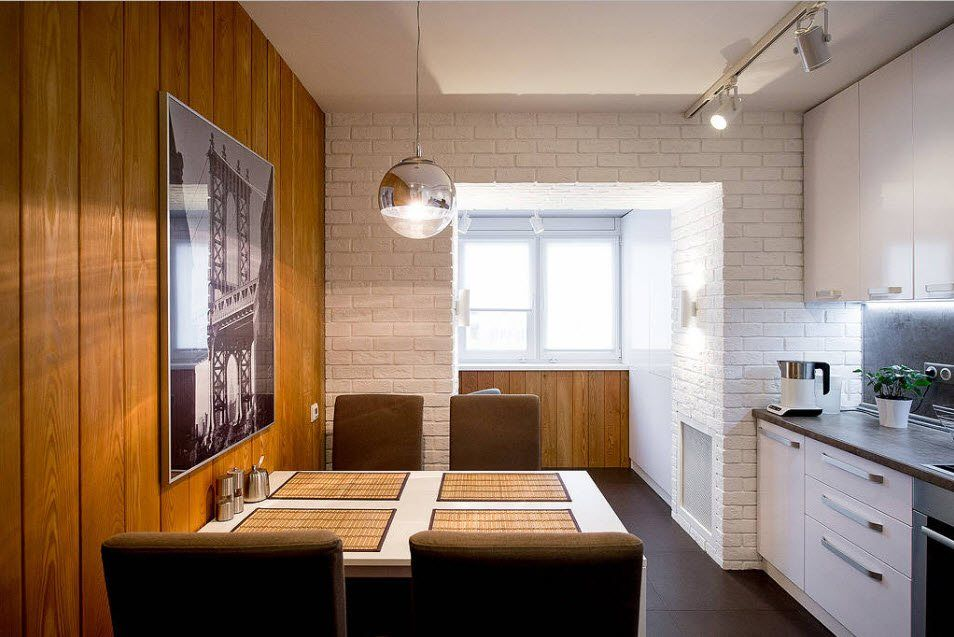 Wooden planked accent wall in the kitchen with open layout and added space of the loggia