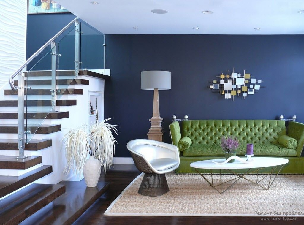 Navy blue for the open layout living room with the stairs at the wall