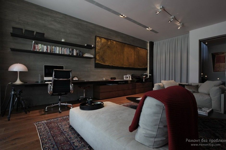 Large picture in the spacious dark tones living room with working zone
