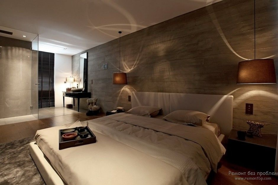 Unusual dark bedroom interior with dark stone accent headboard wall