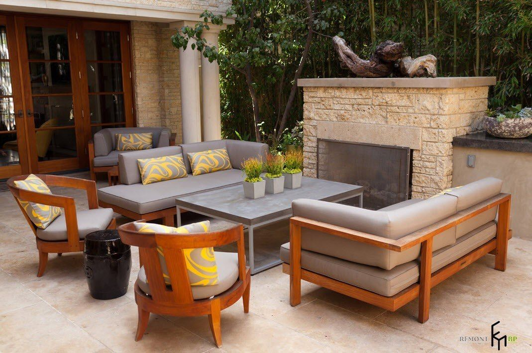 Patio furniture outdoor. Reviewing Types with Photos. Wood and upholstery combined grey furniture set under a canopy