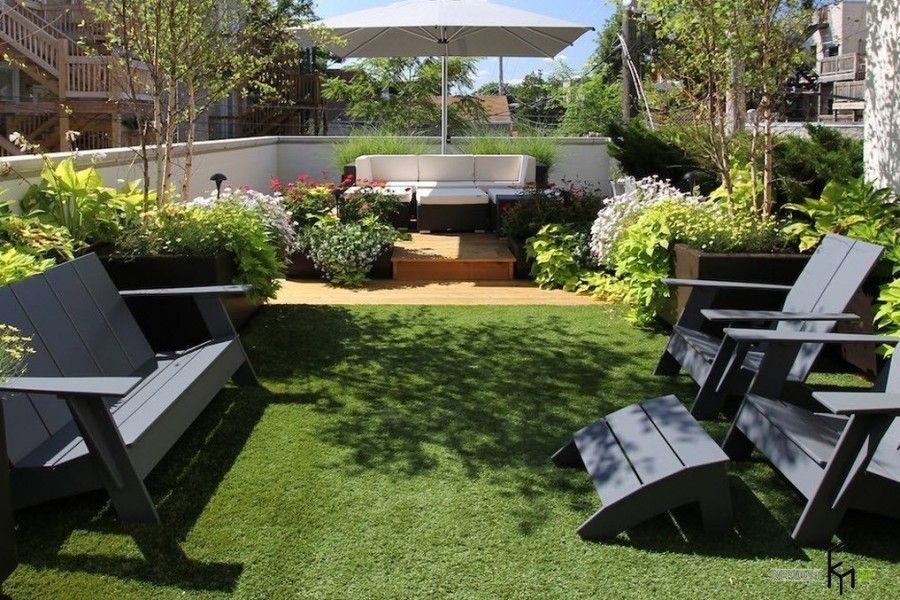 Modern trimmed lawn and the respectful dark furnished patio
