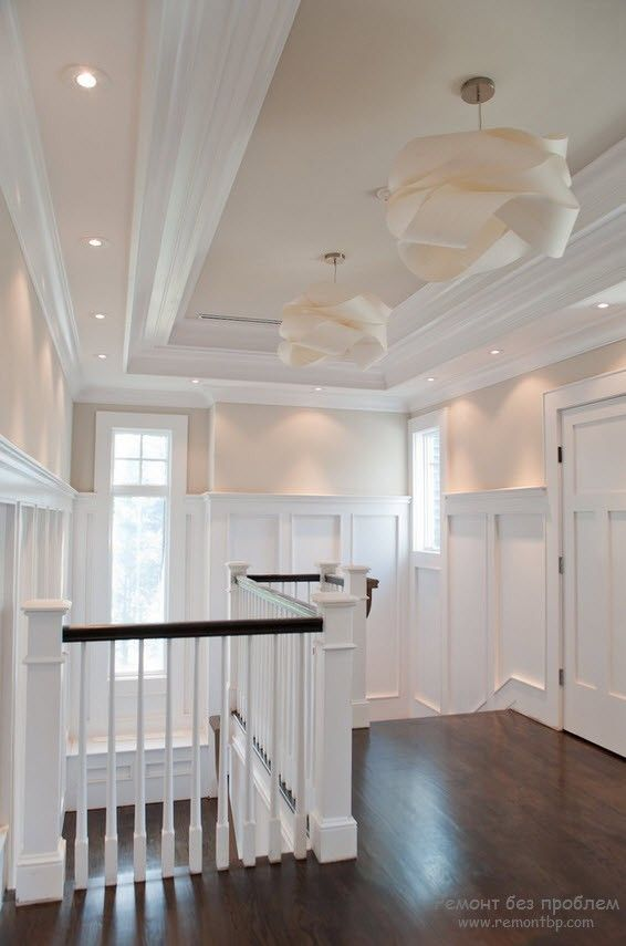 A lot of PVC stucco in the Classic light tones decorated staircase hall in the private house