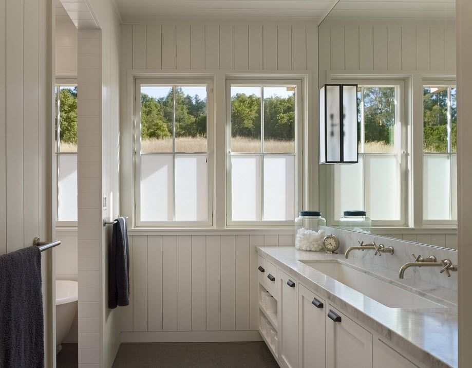 DIY Bathroom Remodel Ideas. Detailed Step by Step Instruction. Classic interior of the large private house's room with natural light and white color theme