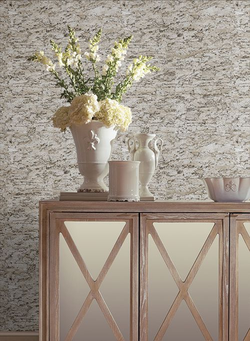Gray textured cork wallpapaer creates the sensation of decorative plaster in the room
