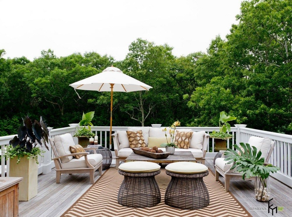 Patio furniture outdoor. Reviewing Types with Photo. Beach umbrella, unusual form of stands for large relaxing zone