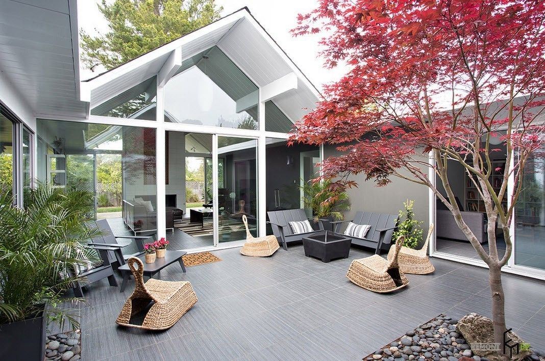 Patio furniture outdoor. Reviewing Types with Photo. Glass walls of the spectacular house