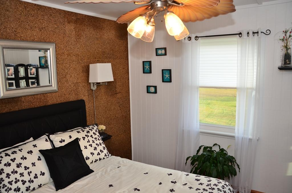 Cork Wallpaper Interior Finishing Advice & Photos. Brown accent wall at the headboard