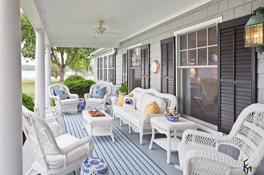 Patio furniture outdoor. Reviewing Types with Photo. White furniture set at the porch of American Classic styled house