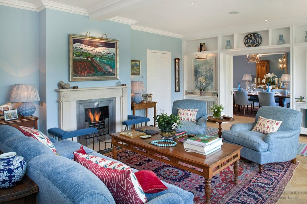 Blue Color Interior Decoraion Ideas. Water Element in Your Home. Powder blue setting in the Classic styled living room with fireplace