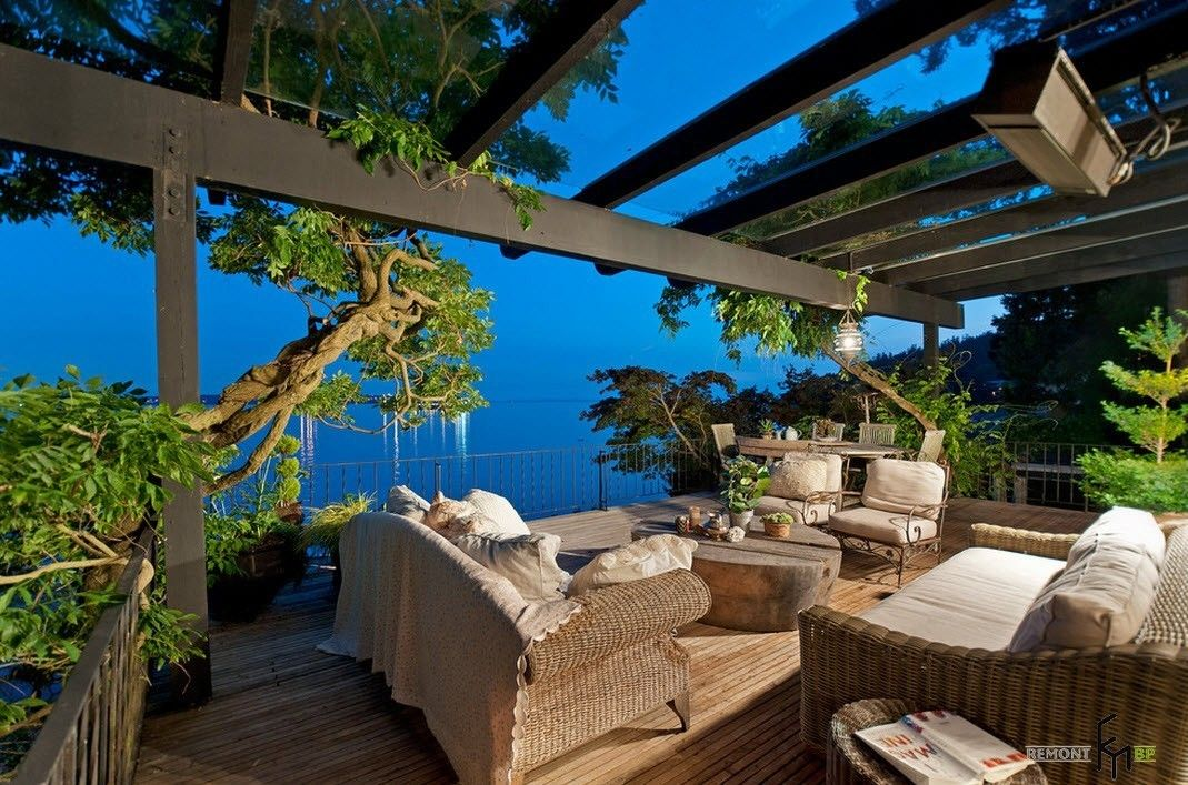 Lattice canopy at the seaside patio with nice coffe with milk colored upholstered furniture