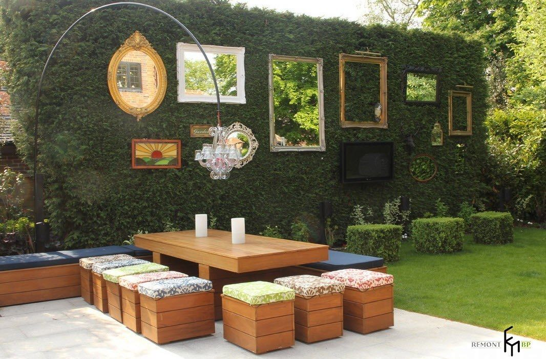Patio furniture outdoor. Reviewing Types with Photo. Unique landscape design at the backyard with pictures at the trimmed bushes