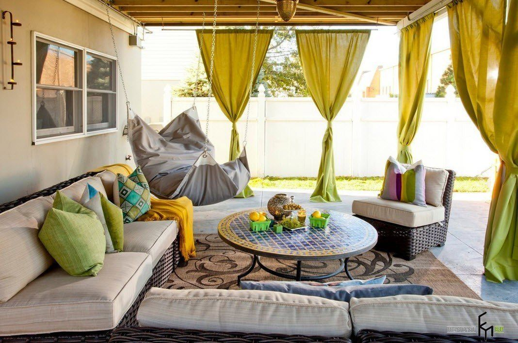 Patio furniture outdoor. Reviewing Types with Photo. Summer heat and the relaxing corner of furniture under the wooden canopy