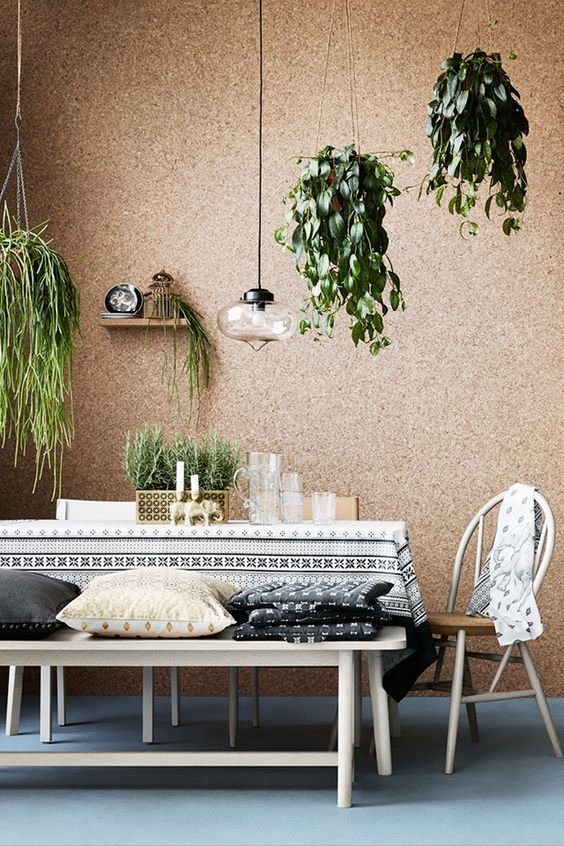 Light brown cork wallpapered wall and the natural decorative elements for unusual living